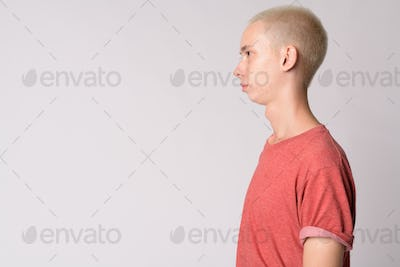 Profile view of young handsome androgynous man