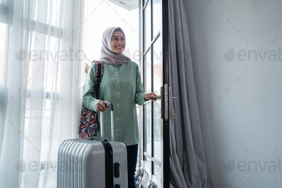 veiled young woman opened the door house