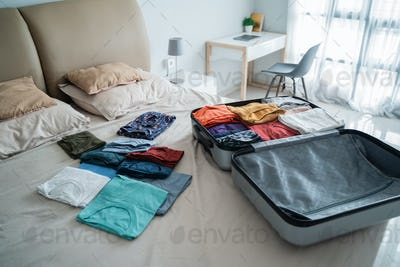 open suitcase with a lot of clothes