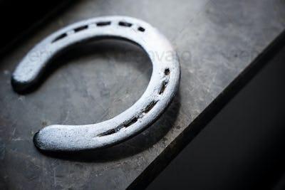 steel polished horseshoe on marble ledge near window