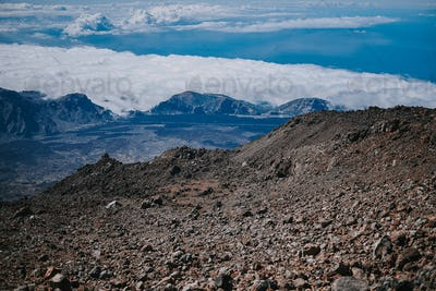Volcanic rocks higher than the clouds on Teide mountain in Tenerife, Spain