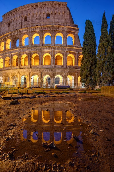 The illuminated Colosseum in Rome at twilight