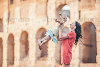 Young mother and little girl exploring Coliseum outside in Rome, Italy