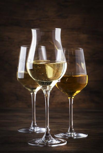 White wine set. Wine tasting, the most popular varieties of white wines in wine glasses