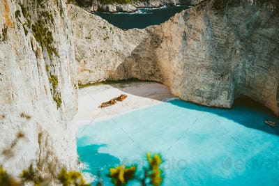 Famous shipwreck of Navagio beach with turquoise blue sea water surrounded by huge white limestone