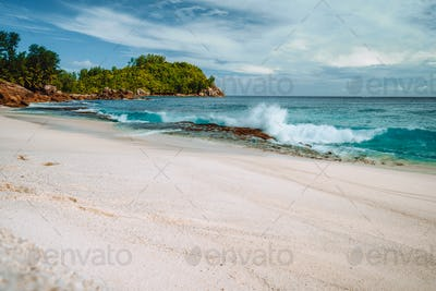 Wave hitting old corals coast at beautiful beach Anse Bazarca, seychelles