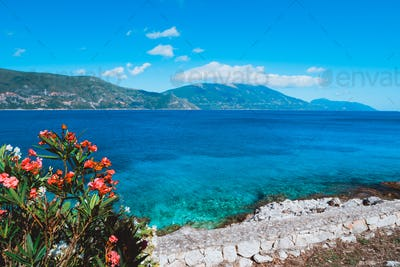 Panorama of crystal clear transparent blue turquoise teal Mediterranean seascape in Fiskardo town