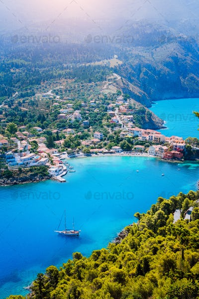 Assos village in morning light, Kefalonia. Greece. White lonely yacht in beautiful turquoise colored