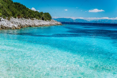 Dafnoudi beach in Kefalonia, Greece. Remote blue lagoon with pure clean turquoise sea water and