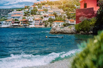 Summer vacations scenery. Mediterranean town Assos on Kefalonia in Greece. View of beautiful beach
