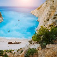 Breathtaking view of Shipwreck middle of sandy Navagio beach surrounded by azure deep turquoise sea