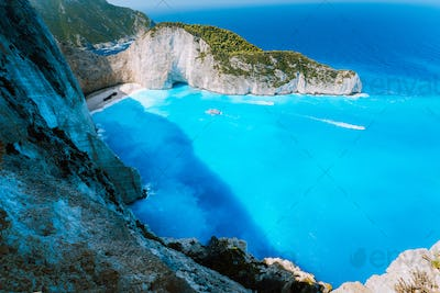 Navagio beach or Shipwreck bay with turquoise water and pebble white beach. Famous landmark location