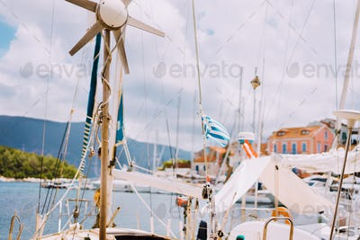 Sailboat detailed parts. Close up of masts of yacht over blue sea. Yachting concept. Soft focus