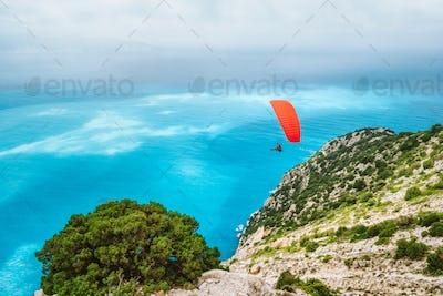 Paraglider flying at Myrtos beach. Kefalonia island, Greece. Recreation hobby activity