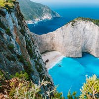 Navagio beach or Shipwreck bay. Turquoise water and pebble white beach in morning light. Famous