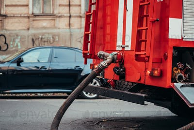 Hoses to quench the fire connecting with water pump valves of fire truck