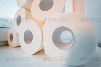 Toilet paper shortage concept with stacked rolls