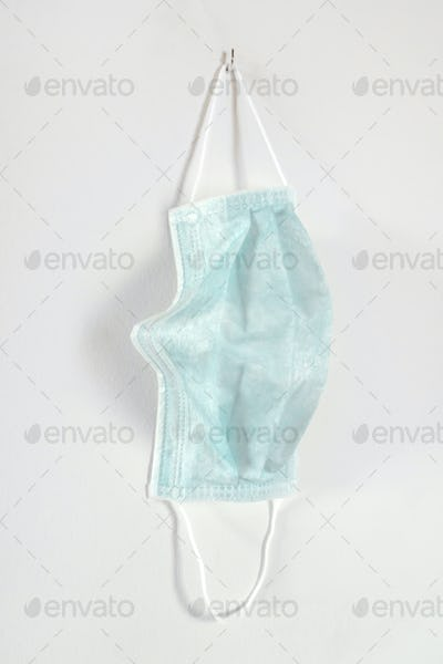 Medical mask hanging on the wall