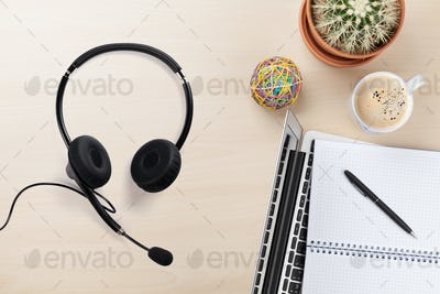 Office wooden backdrop with supplies and headset