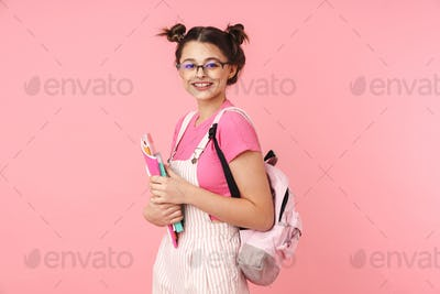 Photo of happy charming girl posing with exercise books and smiling