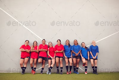 Graphic Shot Of Womens Football Team Leaning Against Wall Whilst Training For Soccer Match
