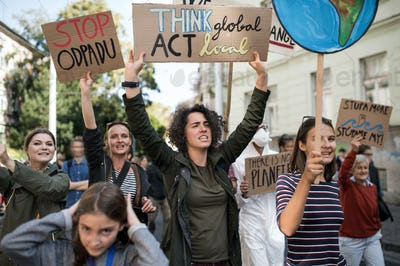 People with placards and posters on global strike for climate change, shouting.