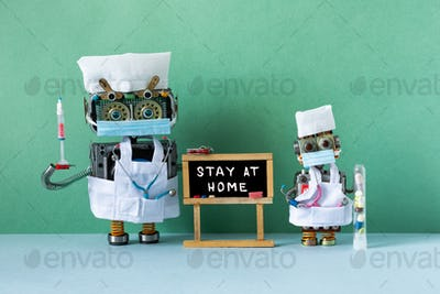 Infectious disease medic robots, black chalkboard with handwritten suggestion Stay at home