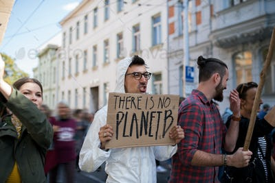 People with placards and protective suit on global strike for climate change