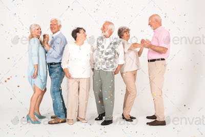 White interior with group of senior happy people in casual cloths