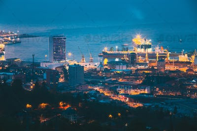 Batumi, Adjara, Georgia. Aerial View Of Urban Cityscape At Evening Or Night. Port Management