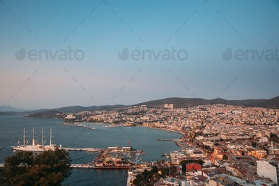 Kusadasi, Aydin Province, Turkey. Waterfront And Kusadasi Cityscape In Summer Evening. Scenic View