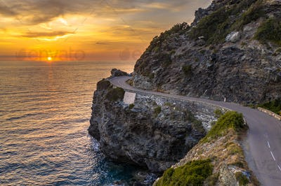 Winding road along rocky coast