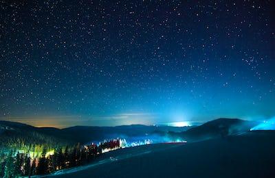 The resort ski resort illuminated at night