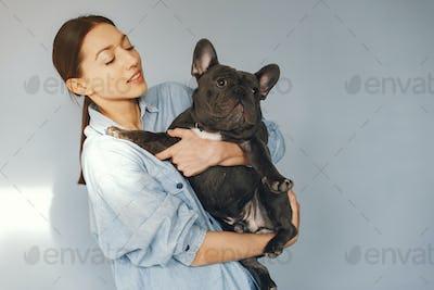 Elegant woman in a blue shirt with black bulldog