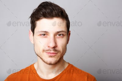 Close up handsome young man against gray background