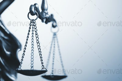 Close up detail of the scales of justice
