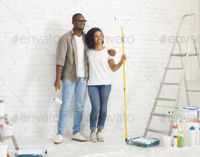 Man and woman preparing for paint new apartment walls