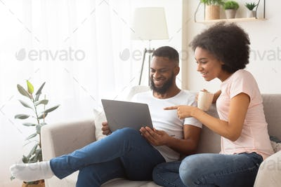 Couple happy to find a purchase in online store