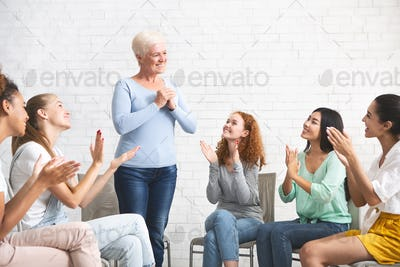 Woman Expressing Gratitude For Psychological Help During Group Therapy Indoors