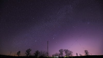 Real Night Sky Stars Above Landscape With Telecommunications Cell Phone Tower Or With Antenna