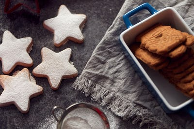 Freshly Baked Star Shaped Christmas Cookies On Board Dusted With Icing Sugar