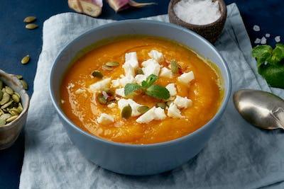 Pumpkin cream soup with sheep cheese, autumn homemade food,