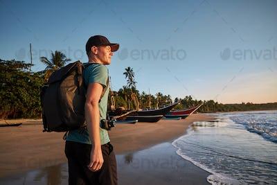 Traveler on beach at morning light