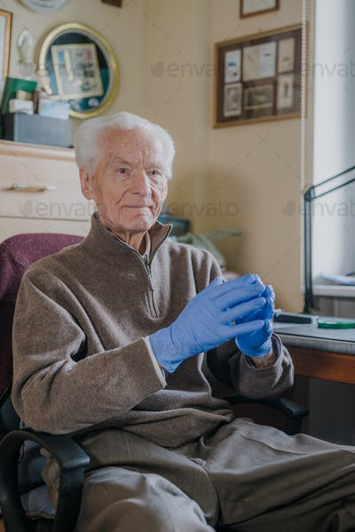 Portrait of Old man wearing Protective Gloves against Covid-19