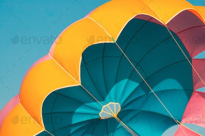Close Multi-colored Parachute For Parasailing On Background Of Blue Sky