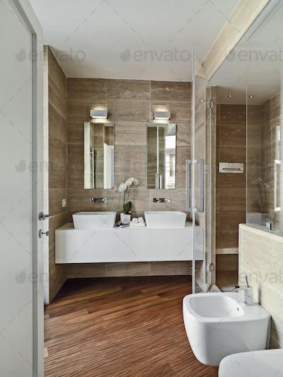 Interiors of the Modern Bathroom with Wood Floor