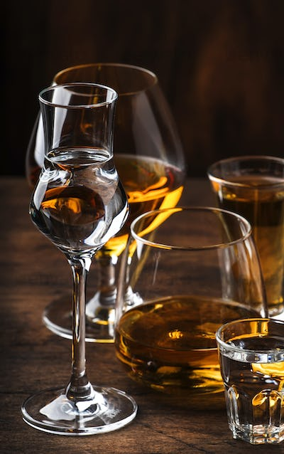Strong Spirits Set. Hard alcoholic drinks in glasses in assortment