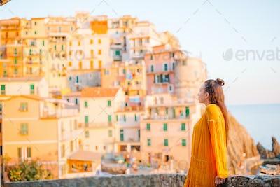 Tourist looking at scenic view of Manarola, Cinque Terre, Liguria, Italy