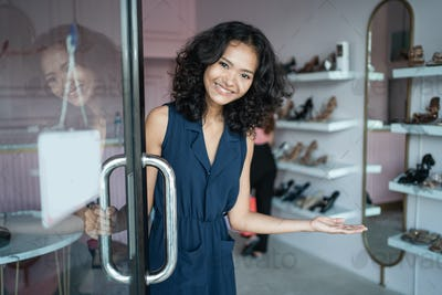 asian fashion shop owner at her boutique