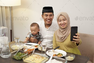 muslim family make video phone call while dinner